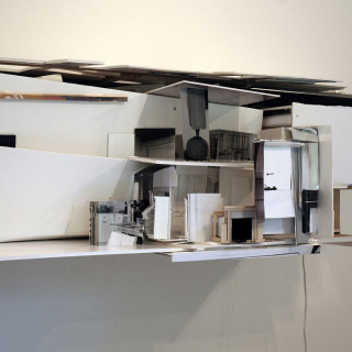 Photographs, foam core, cardboard, wood and miniature furniture built into large architectural -like model