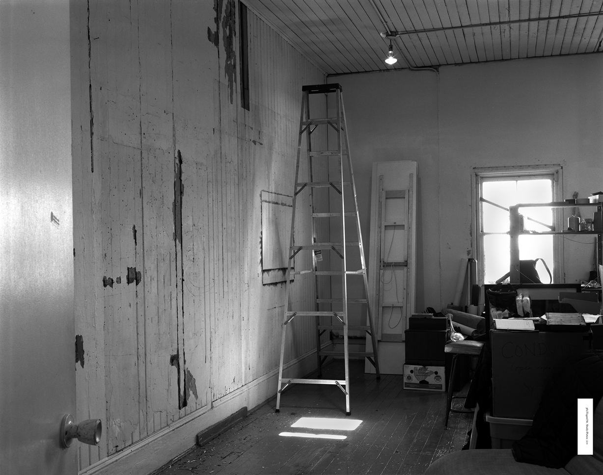 B&W photograph of 562 studio
