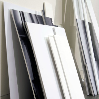 digital photographs mounted on foam core, leaning against gallery wall
